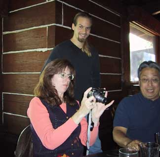 Waylon (the message board guru) discussed digital photography with Whiskey Woman and Charlie.